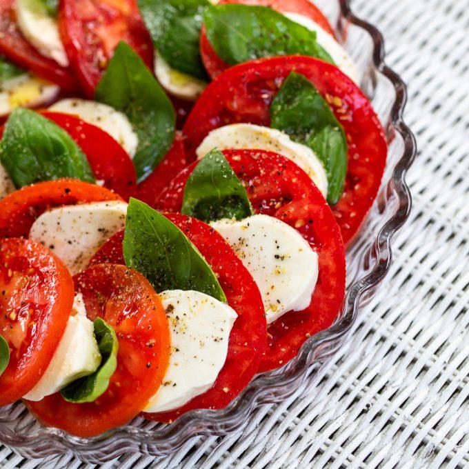Tomatoes, mozzarella and basil scalloped in a small tart pan.