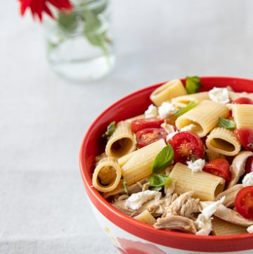 Bowl of caprese chicken pasta salad.