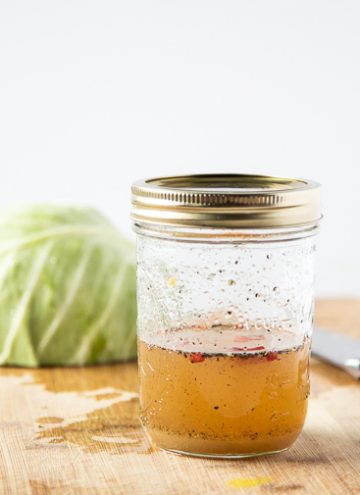 Jar of coleslaw vinaigrette.