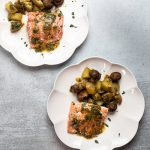 Two plates of sheet pan salmon.