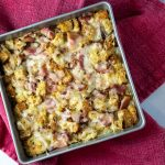 Savory bread pudding in a square pan.