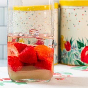 Jar with strawberries, sugar and rum.