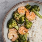 Bowl of roasted shrimp and broccoli.