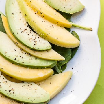 Plate with slices of avocado and mango