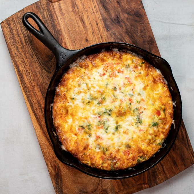 Cheesy frittata in a cast iron skillet.