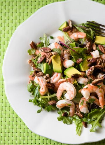 Overhead shot of shrimp, avocado and grapefruit salad
