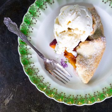 Peach tart with a scoop of ice cream.
