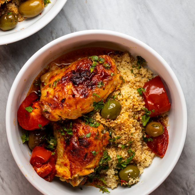 Bowl with harissa chicken thighs.