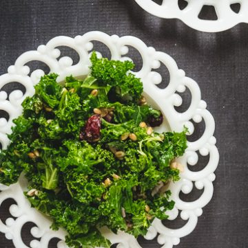 white scalloped plate with kale salad