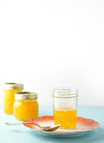 Three jars of bright orange mango marmalade
