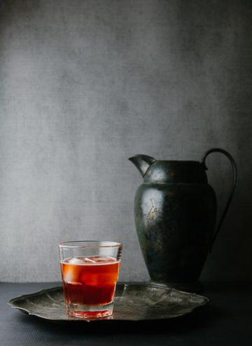 Dark red cocktail on a silver plattter