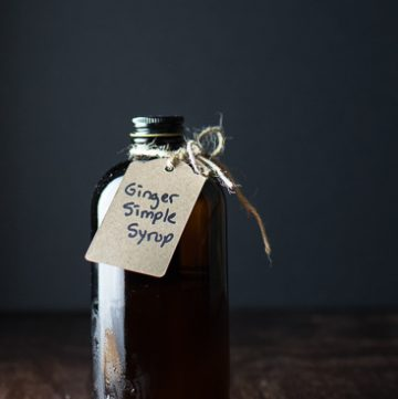 Brown bottle with tag reading ginger simple syrup