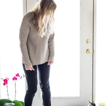 Philosophy sweater with black pants and flats,