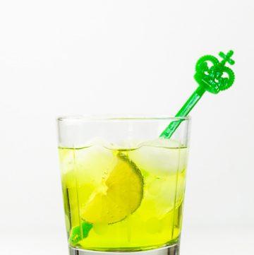 Bright green midori gin and tonic
