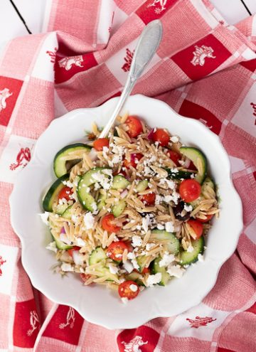 white bowl filled with Greek Orzo Salad