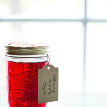 Jar filled with bright red liquid.