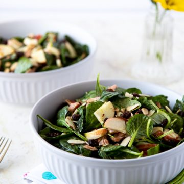 Two bowls of spinach salad with Smoked salmon