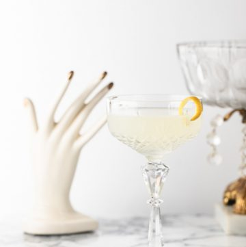 White lady cocktail in a decorative coupe glass.