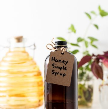 Brown Bottle with tag reading Honey Simple Syrup