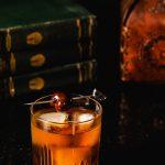 Deep orange Vieux Carré cocktail.