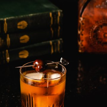 Deep orange Vieux Carré cocktail.