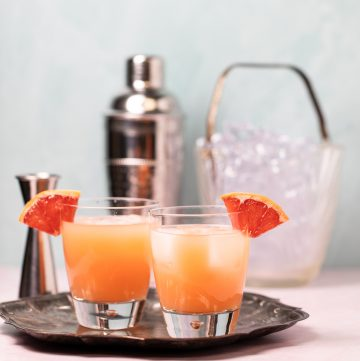Two glasses of a pretty orange greyhound cocktail.
