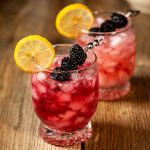 Two Blackberry Bramble cocktails.