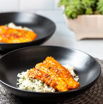 Bowl of glazed salmon over rice