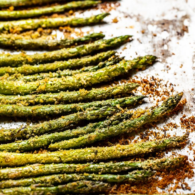 Close up of roasted asparagus with crispy browned bread crumbs.