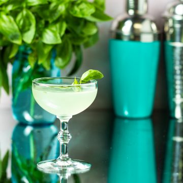 Light green cocktail in a coupe glass.