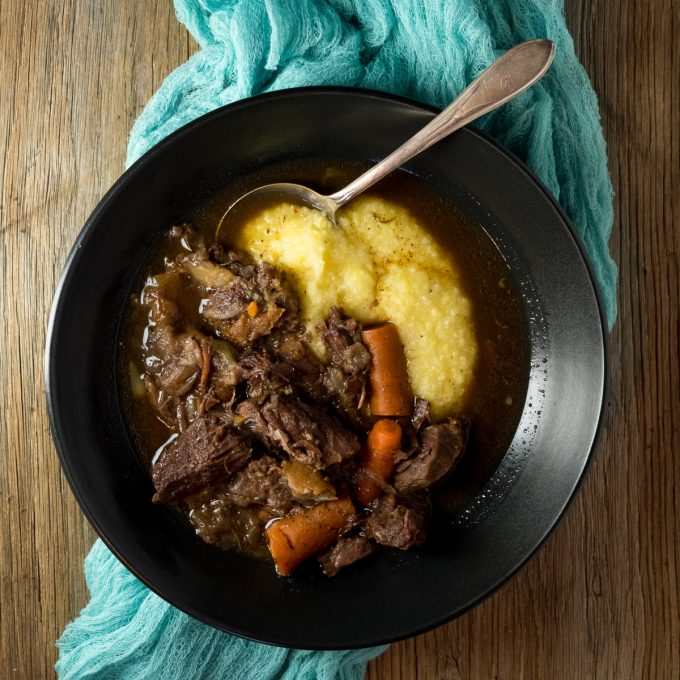 Bowl filled with beef stew.