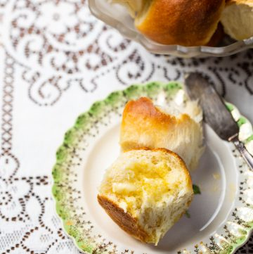 Antique plate with buttery roll on it.