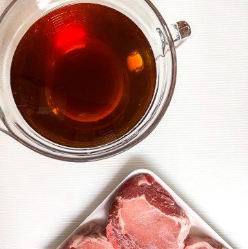 Bowl of brine with pork chops.